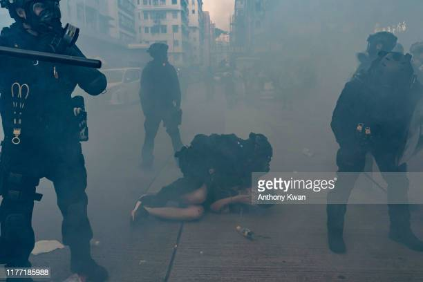 A prodemocracy protester is arrested by riot police in a cloud of tear gas during a demonstration on October 20 2019 in Hong Kong China Hong Kong's...