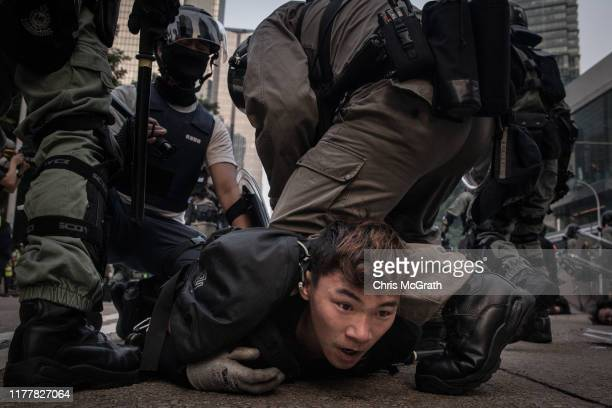 Pro-democracy protester is tackled and arrested by police during clashes after a march on September 29, 2019 in Hong Kong, China. Pro-democracy...