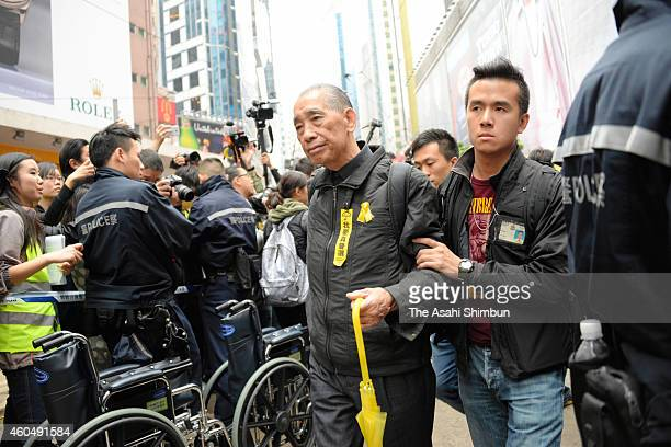A prodemocracy protester is taken after arrest while police officers remove barricades and tents in occupied areas at Causeway Bay on December 15...