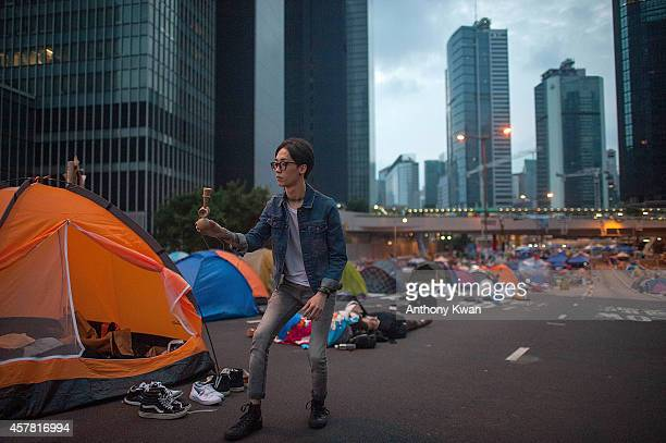 A prodemocracy protester plays kendama on a street near Hong Kong Government Complex at Admiralty district on October 24 2014 in Hong Kong Hong Kong...