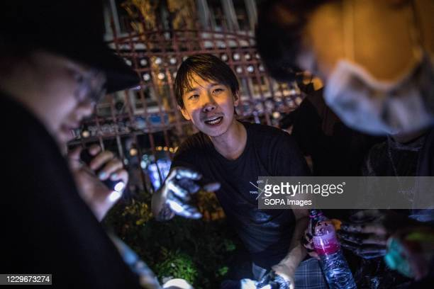 Pro-democracy protester prepares black paint balls to throw at Police officers inside the Royal Thai Police Headquarter during an anti-government...