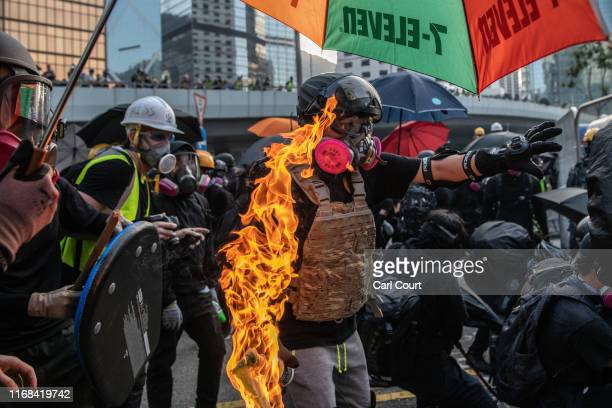 A prodemocracy protester prepares to throw a petrol bomb at the Central Government Offices on September 15 2019 in Hong Kong China Prodemocracy...