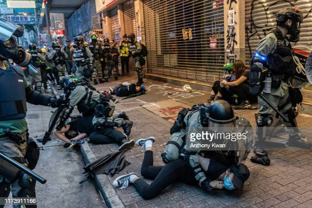 Pro-democracy protesters are arrested by police during a clash at a demonstration in Wan Chai district on October 6, 2019 in Hong Kong, China. Hong...