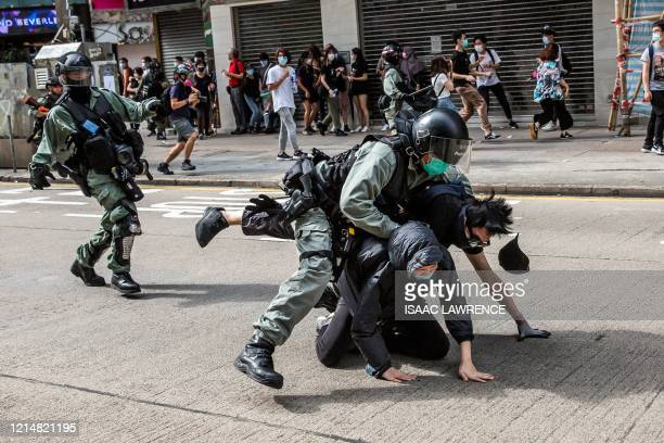 TOPSHOT Prodemocracy protesters are arrested by police in the Causeway Bay district of Hong Kong on May 24 ahead of planned protests against a...