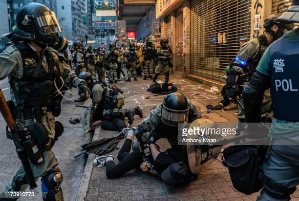 Prodemocracy protesters arrested by police during a clash at a demonstration in Wan Chai district on October 6 2019 in Hong Kong China Hong Kong's...