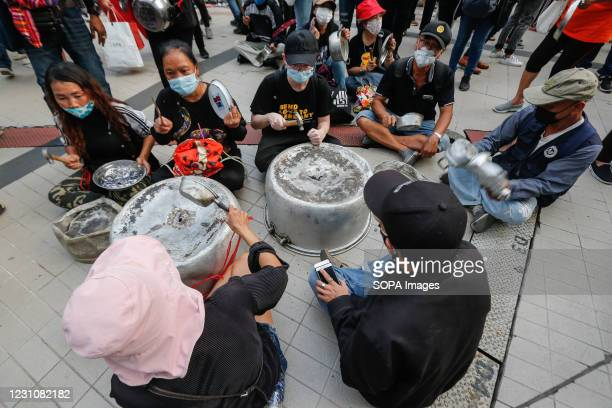 Pro-democracy protesters banging saucepans during a rally demanding the prime minister to resign and reforms in the monarchy. Thousands of...