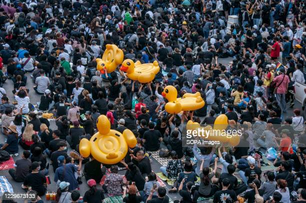 Pro-democracy protesters carrying inflatable ducks during the demonstration. Pro-democracy protesters gathered at Ratchaprasong intersection and...