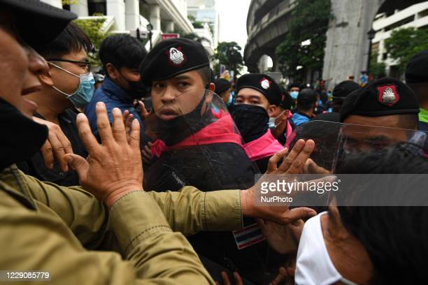 Pro-democracy protesters combat police officers during a rally at Ratchaprasong interjection central of Bangkok near Royal Thai Police Headquarter on...