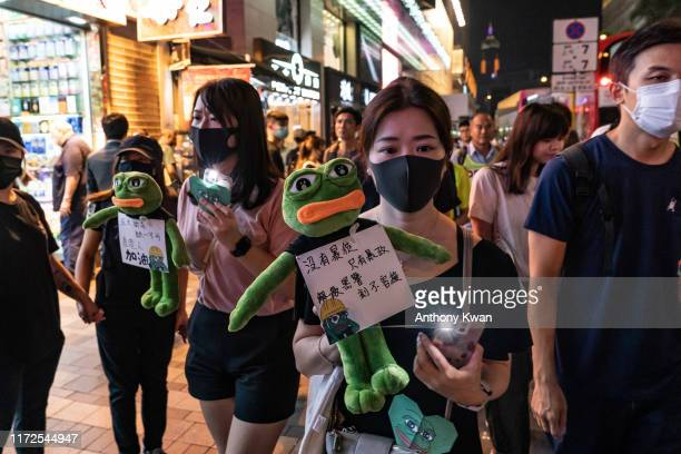 Prodemocracy protesters form a Pepe the Frog themed human chain from Tsim Sha Tsui to Prince Edward on September 30 2019 in Hong Kong China...
