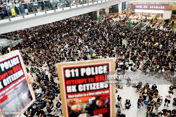 Prodemocracy protesters gather against the police brutality and the controversial extradition bill at Hong Kong's international airport on August 12...