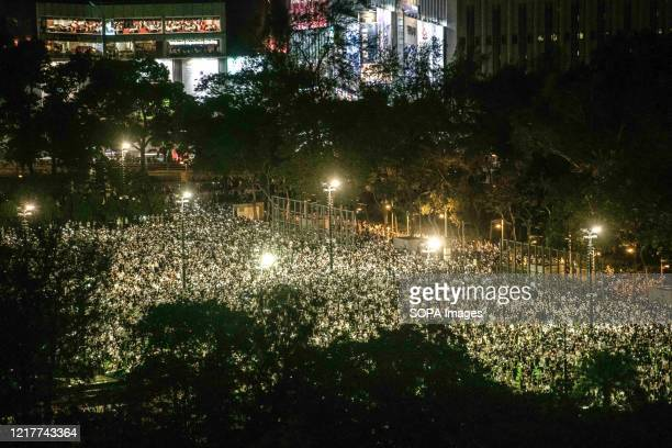 Pro-democracy protesters gather at Victoria Park during a memorial vigil. Thousands gathered for the annual memorial vigil in Victoria Park to mark...