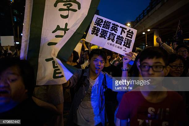 Prodemocracy protesters hold banners protesting during Hong Kong Chief Executive Leung Chunying visit to Mei Foo to publicize the proposals on the...