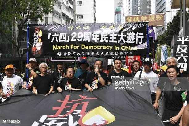 Prodemocracy protesters march in Hong Kong on May 27 demanding the end of China's oneparty dictatorship ahead of the 29th anniversary of the bloody...