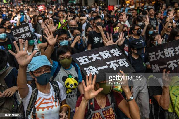 Prodemocracy protesters march on September 15 2019 in Hong Kong China Prodemocracy protesters have continued demonstrations across Hong Kong calling...