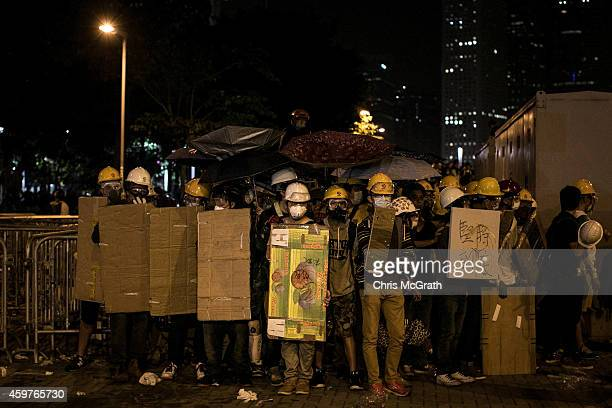 Prodemocracy protesters prepare to clash clash with police outside Hong Kong's Government complex on December 1 2014 in Hong Kong Leaders from the...