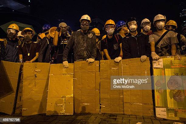 Pro-democracy protesters prepare to clash with police outside Hong Kong's Government complex on December 1, 2014 in Hong Kong. Leaders from the...