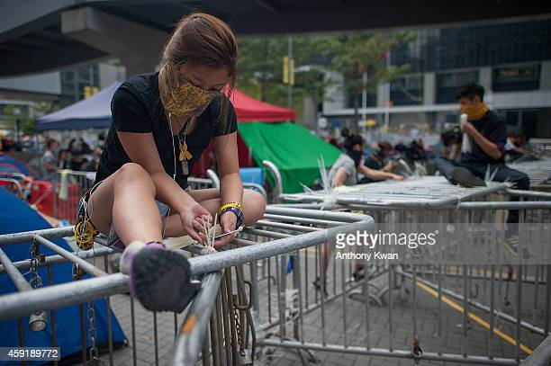 Pro-democracy protesters reinforce barricades with cable ties on a street outside of Citic Tower on November 18, 2014 in Hong Kong. Bailiffs oversaw...