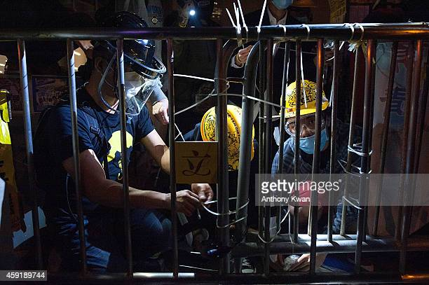 Pro-democracy protesters reinforce barricades with cable ties outside of Legislative Council building on November 19, 2014 in Hong Kong. Hong Kong's...