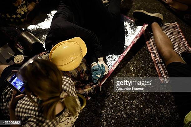 Prodemocracy protesters rest inside a barricade at Mong Kok on October 20 2014 in Hong Kong Hong Kong Expected clashes between prodemocracy...