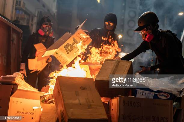 Pro-democracy protesters set a barricade on fire during a demonstration in Causeway Bay district on November 2, 2019 in Hong Kong, China....