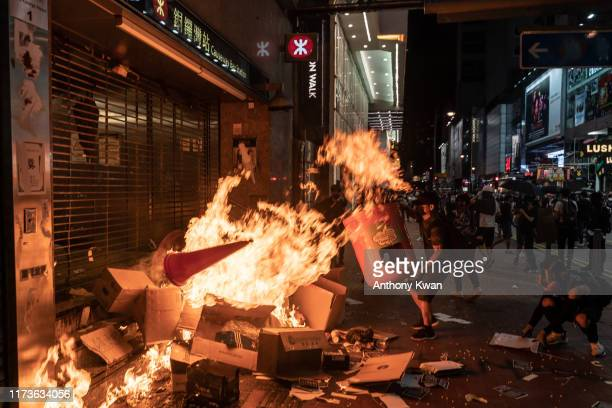 Pro-democracy protesters set a fire at the entrance of the MTR station during a demonstration at Causeway Bay district on October 4, 2019 in Hong...