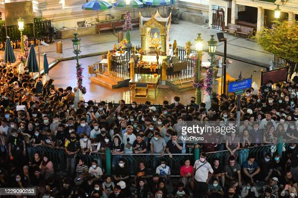 Pro-democracy protesters stand around Erawan Shrine at Ratchaprasong interjection central of Bangkok near Royal Thai Police Headquarter on October...