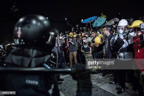 Prodemocracy protesters stand off with police officers outside the Legislative Council building after clashes with prodemocracy activists on November...