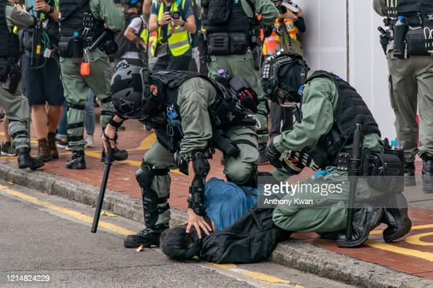 A prodemocracy supporter is detained by riot police during an antigovernment rally on May 24 2020 in Hong Kong China Chinese Premier Li Keqiang said...