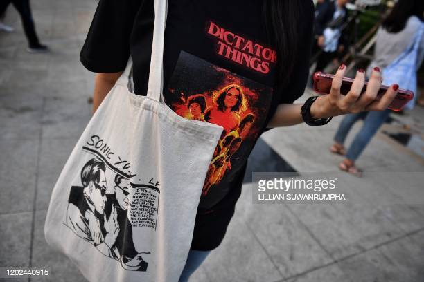 Pro-democracy supporter sports Stranger Things and Sonic Youth-inspired gear mocking Thai prime minister Prayut Chan-O-Cha, a day after the...
