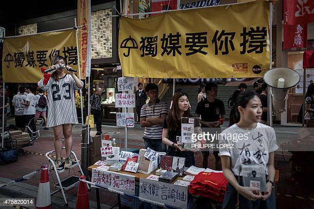 Prodemocracy supporters distribute leaflets and shout slogans before the commemoration of China's 1989 Tiananmen Square crackdown in Hong Kong on...