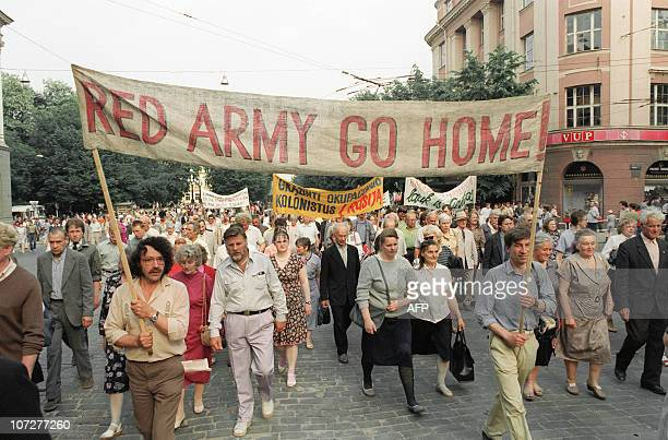 Prodemocracy supporters holding banner asking for the withdraw of Red Army from Lithuania march 22 June 1991 in Vilnius commemorating the 50the...