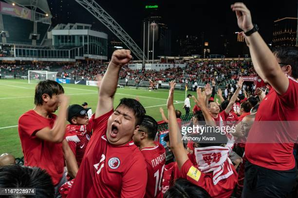 Prodemocracy supporters make shout slogans during the FIFA World Cup Qatar 2022 and AFC Asian Cup China 2023 preliminary joint qualification at the...