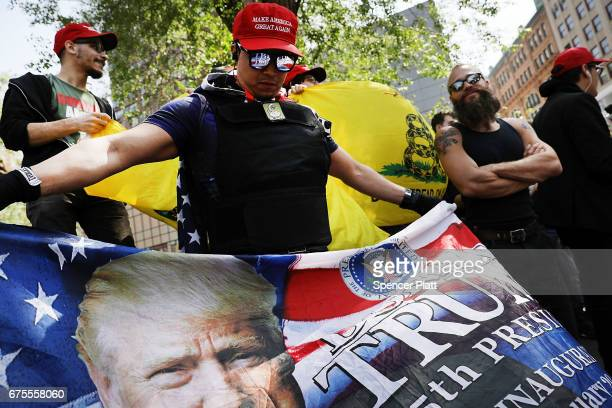 A proDonald Trump group demonstrates across the street from hundreds of liberal protesters in Union Square on May Day on May 1 2017 in New York City...