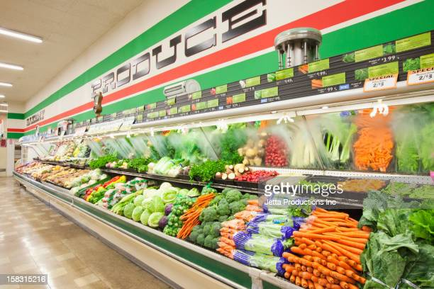 produce aisle in grocery store - jetta productions stock pictures, royalty-free photos & images