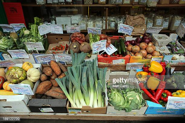Produce is seen displayed outside a shop on the main shopping street of Totnes on January 8 2013 in Totnes England The Devon town is renowned for its...