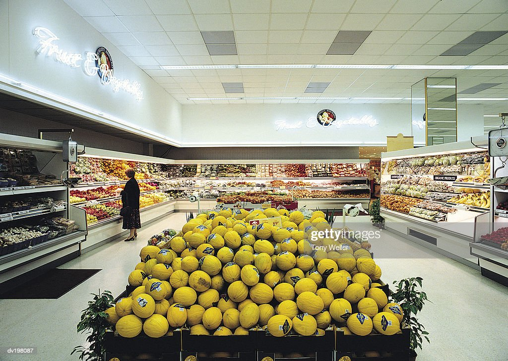 Produce section of grocery store : Stock Photo