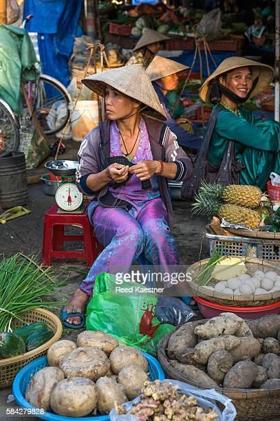 Produce vendor in outdoor market in Vietnam