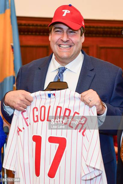 Producer Adam F Goldberg is presented with customized official Philadelphia Phillies shirt and cap during an event honoring Goldberg at Philadelphia...