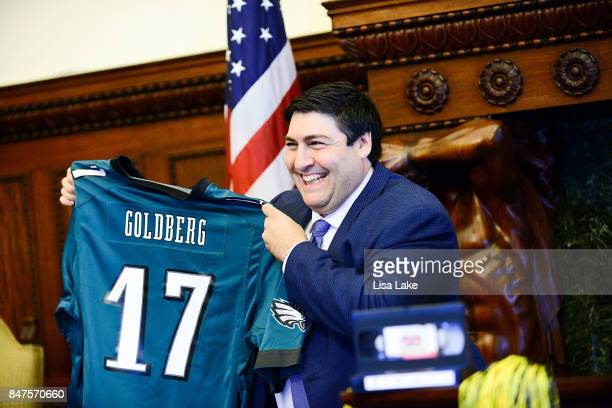 Producer Adam F Goldberg is presented with customized Philadelphia Eagles shirt during an event honoring Goldberg at Philadelphia City Hall on...