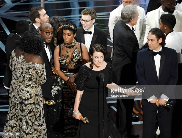 Producer Adele Romanski writer/director Barry Jenkins actor Janelle Monae producer Jeremy Kleiner and cast/crew members accept Best Picture for...