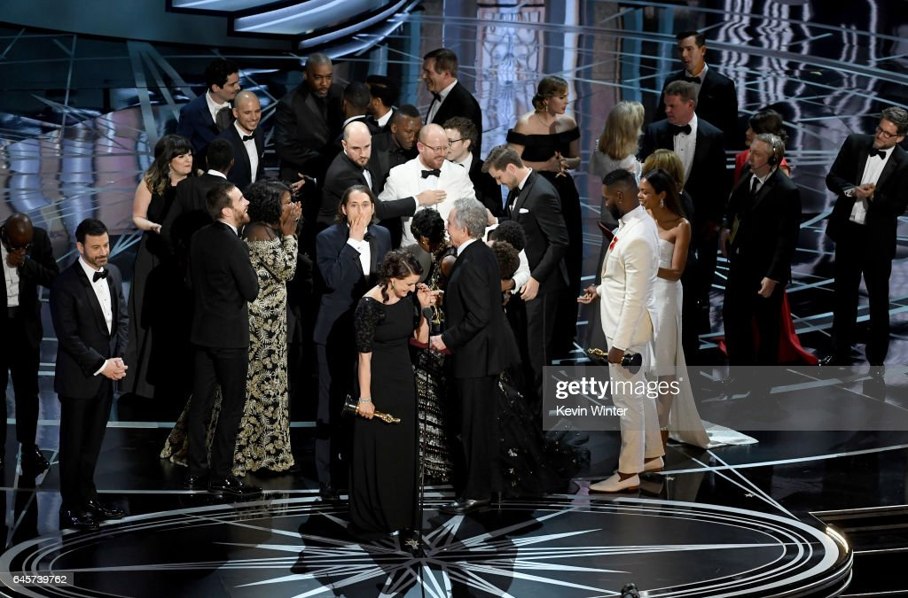 Producer Adele Romanski (C), writer/director Barry Jenkins, producer Jeremy Kleiner and cast/crew members accept Best Picture for 'Moonlight' onstage during the 89th Annual Academy Awards at Hollywood & Highland Center on February 26, 2017 in Hollywood, California.
