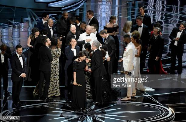 Producer Adele Romanski writer/director Barry Jenkins producer Jeremy Kleiner and cast/crew members accept Best Picture for 'Moonlight' onstage...