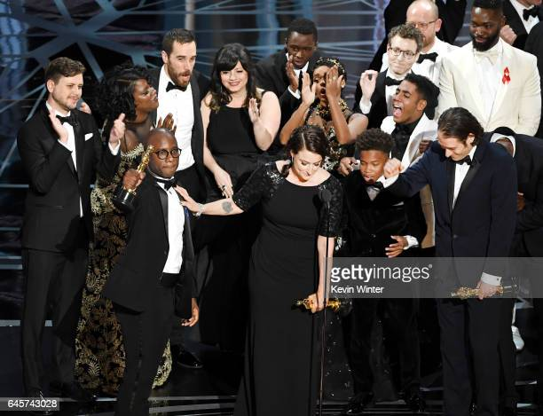 Producer Adele Romanski , writer/director Barry Jenkins, producer Jeremy Kleiner and cast/crew members accept Best Picture for 'Moonlight' onstage...