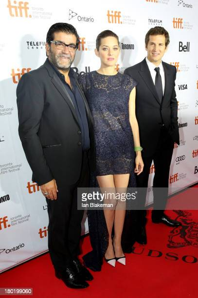 Producer Alain Attal actress Marion Cotillard and director/ writer Guillaume Canet attend 'Blood Ties' Premiere at Roy Thomson Hall on September 9...