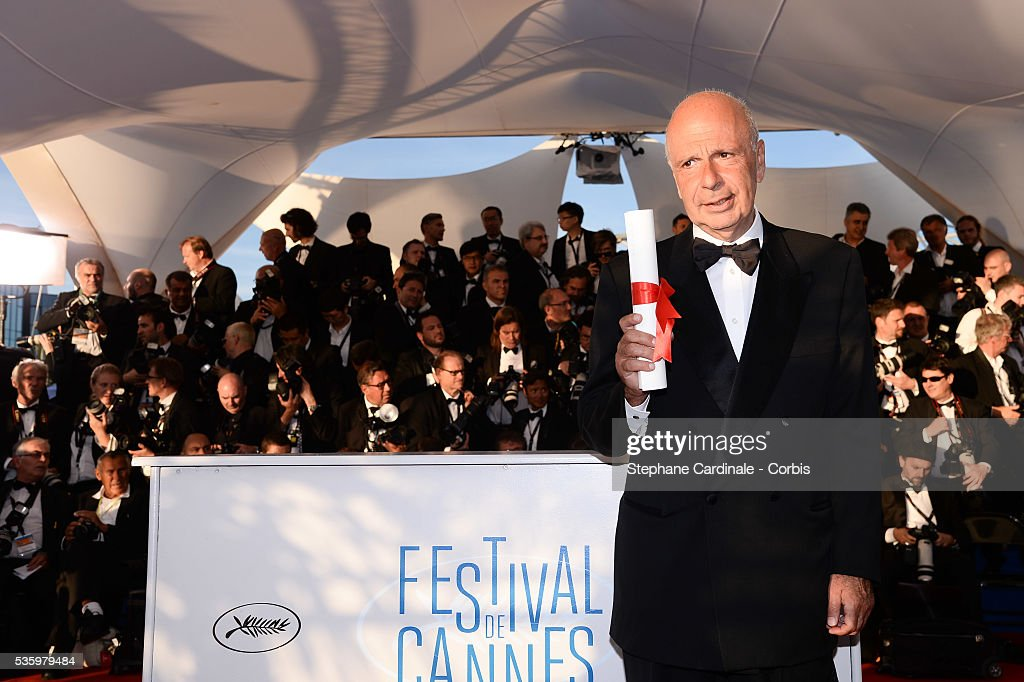 Producer Alain Sarde poses with The Jury Prize on behalf of director Jean-Luc Godard who won for his film 'Goodbye to Language' at the Winners photocall during 67th Cannes Film Festival