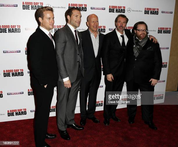 Producer Alex Young actors Jai Courtney Bruce Willis and Sebastian Koch and director John Moore attend the UK Premiere of 'A Good Day To Die Hard' at...