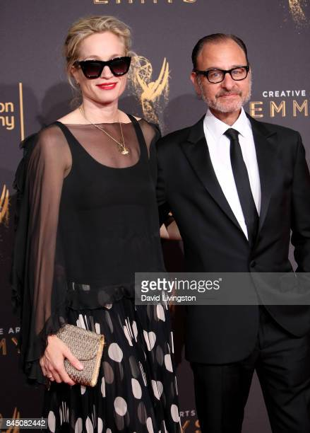 Producer Alexis Bloom and actor Fisher Stevens attend the 2017 Creative Arts Emmy Awards at Microsoft Theater on September 9 2017 in Los Angeles...