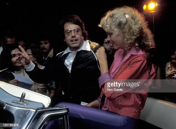 Producer Allan Carr and singer Olivia NewtonJohn attend the 'Grease' Premiere Party on June 13 1978 at Studio 54 in New York City
