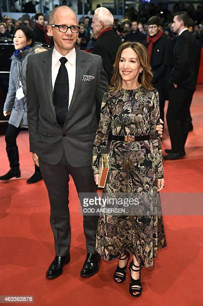 US producer Alli Shearmur and guest pose for photographers on the red carpet as tehy arrive for teh screening of the film 'Cinderella' presented in...