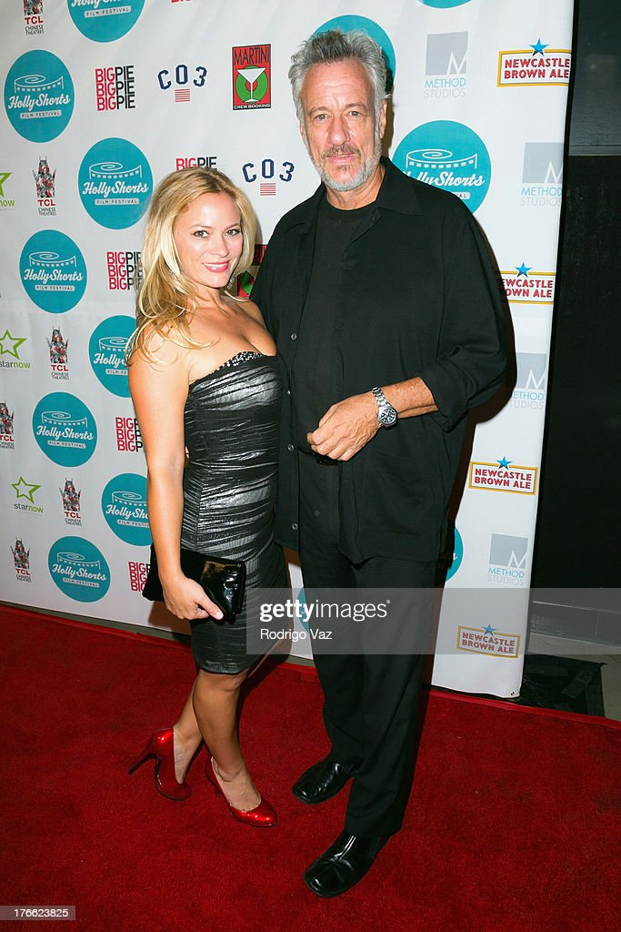 Producer Amy Hedrick (L) and actor John de Lancie attend the 9th Annual HollyShorts Film Festival Opening Night Arrivals at TCL Chinese Theatre on August 15, 2013 in Hollywood, California.